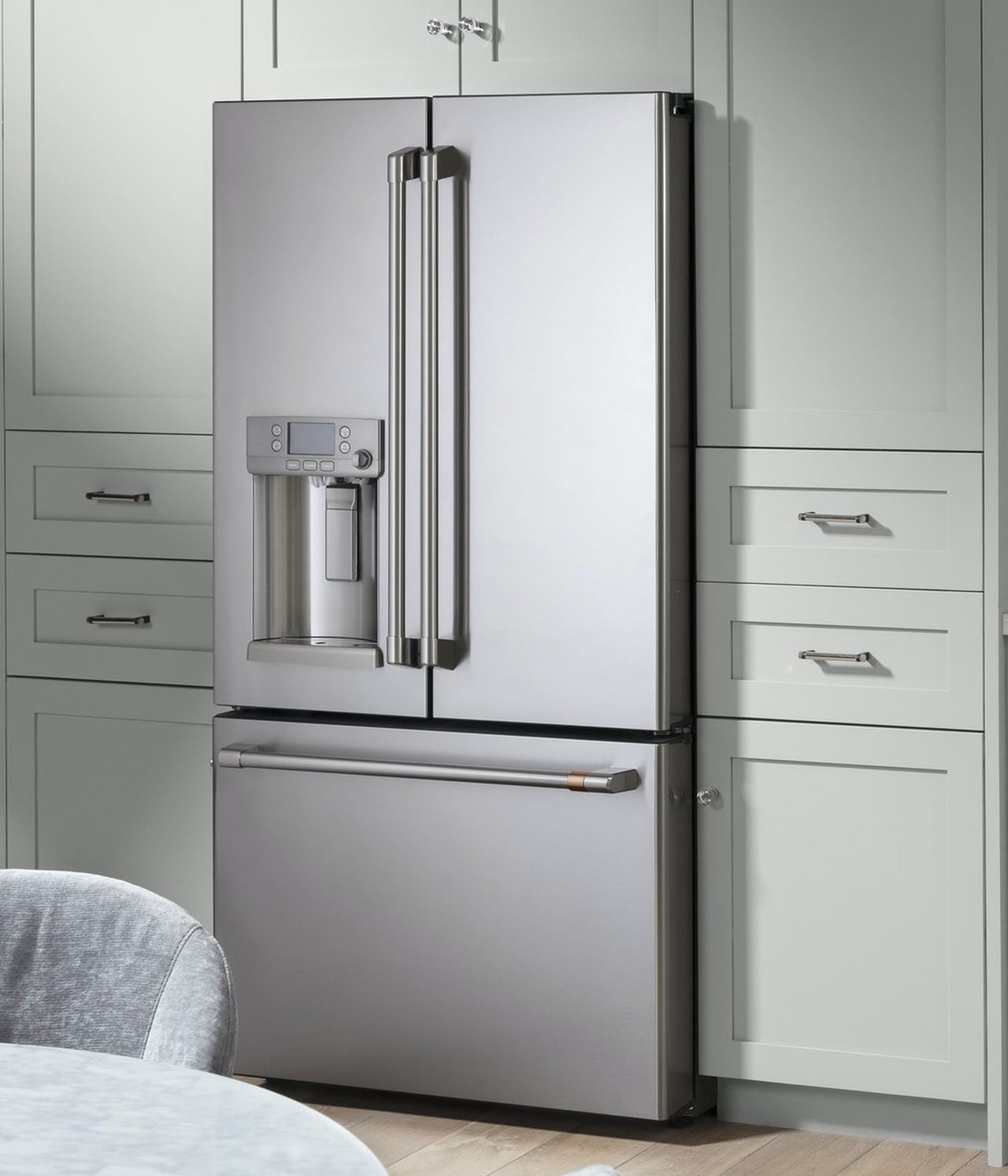stainless steel french door refrigerator with brushed stainless hardware
