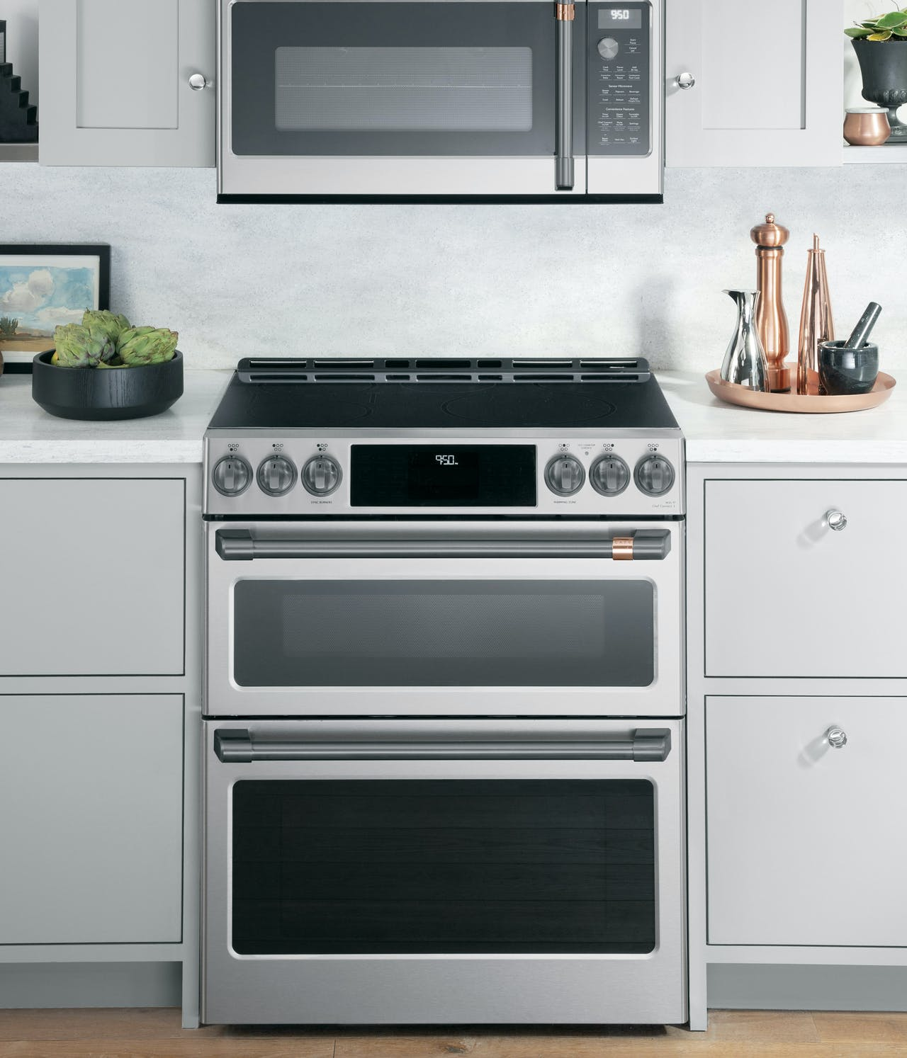stainles slide in electric range with brushed black hardware