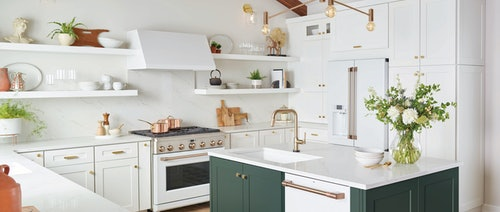white matte kitchen with brushed bronze, stainless steel, and copper