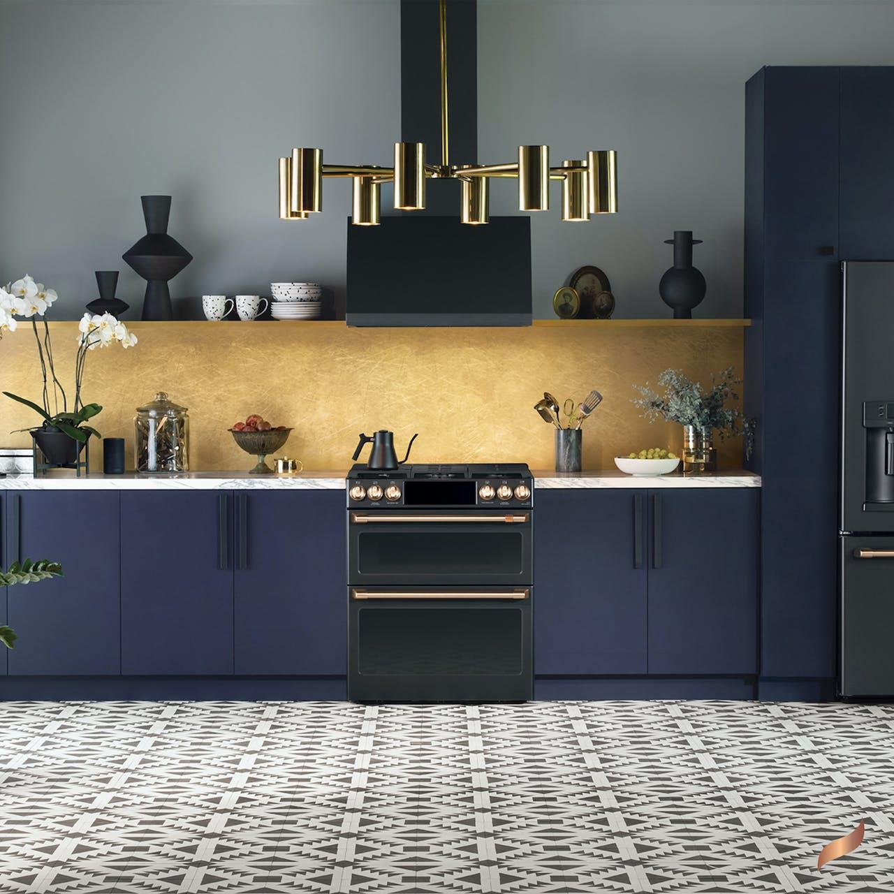 Matte black range in kitchen with navy cabinets