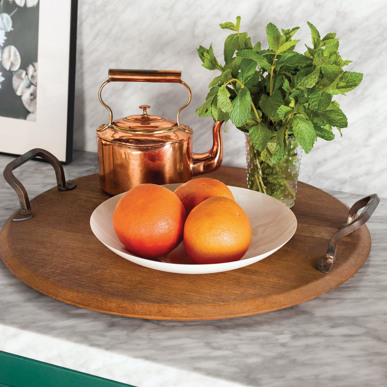 Copper teapot with mint