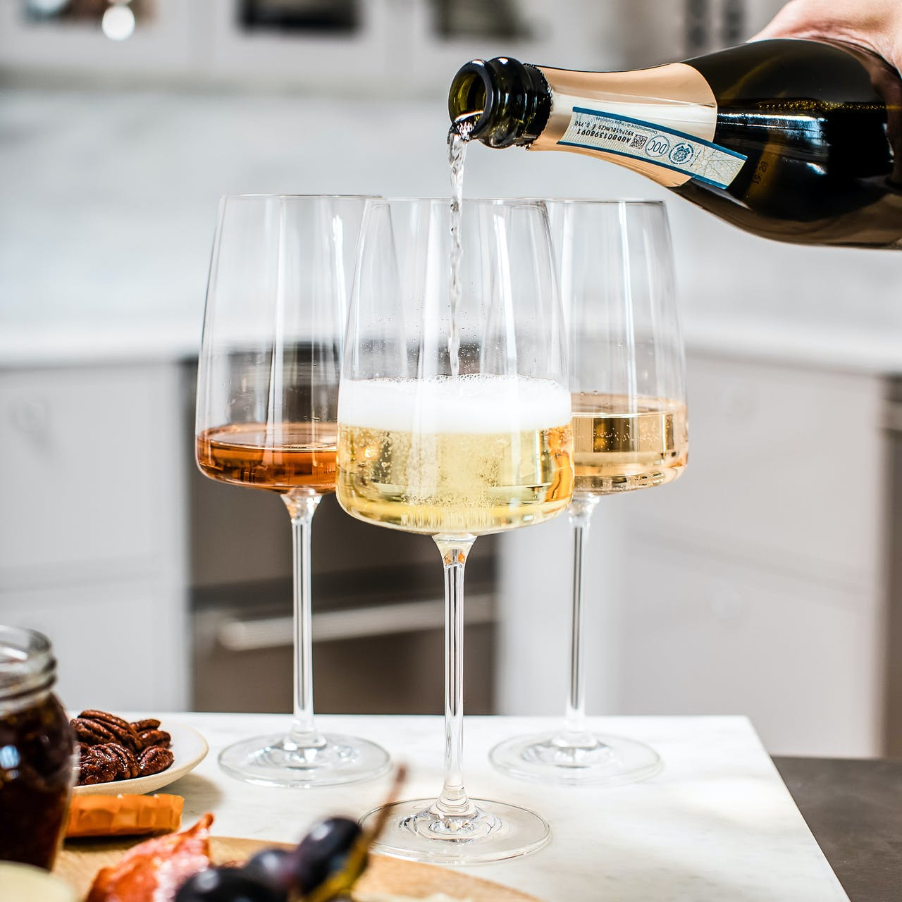 sparkling wine being poured into a wine glass