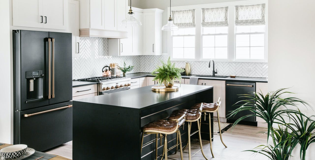 matte black appliances in kitchen with white cabinets