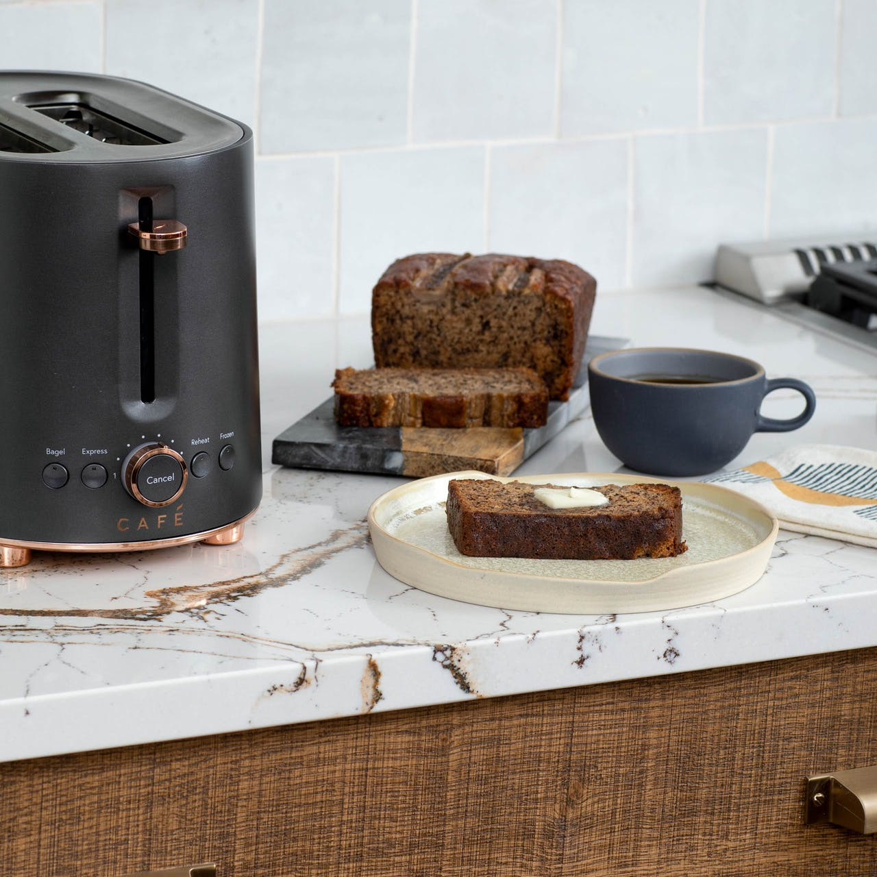 matte black toaster next to slice of toasted banana bread