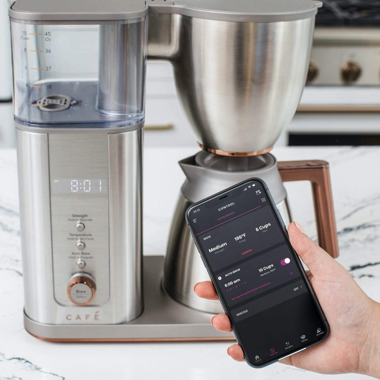 smartHQ app on phone by cafe coffee maker