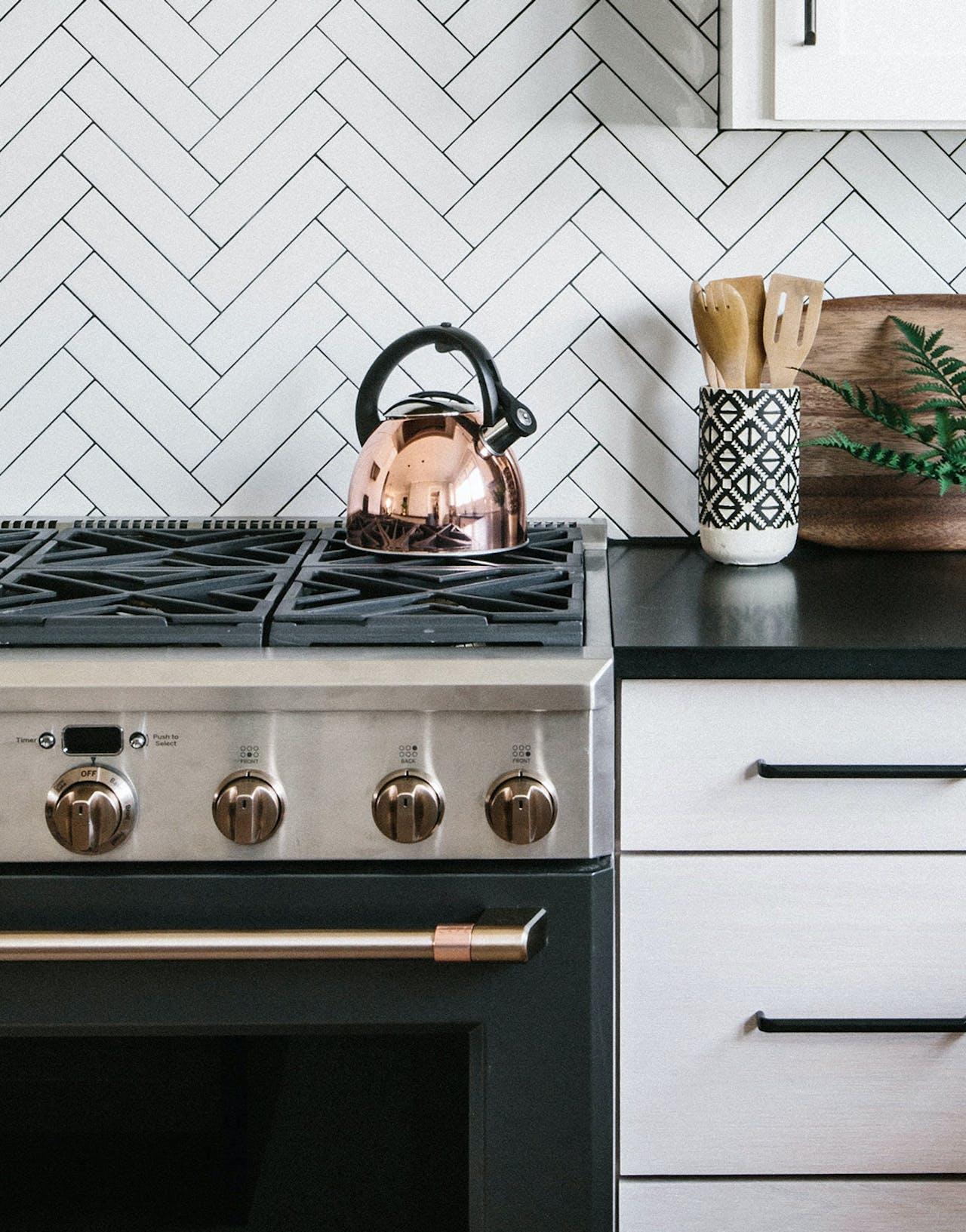 matte black professional range with copper tea kettle on top