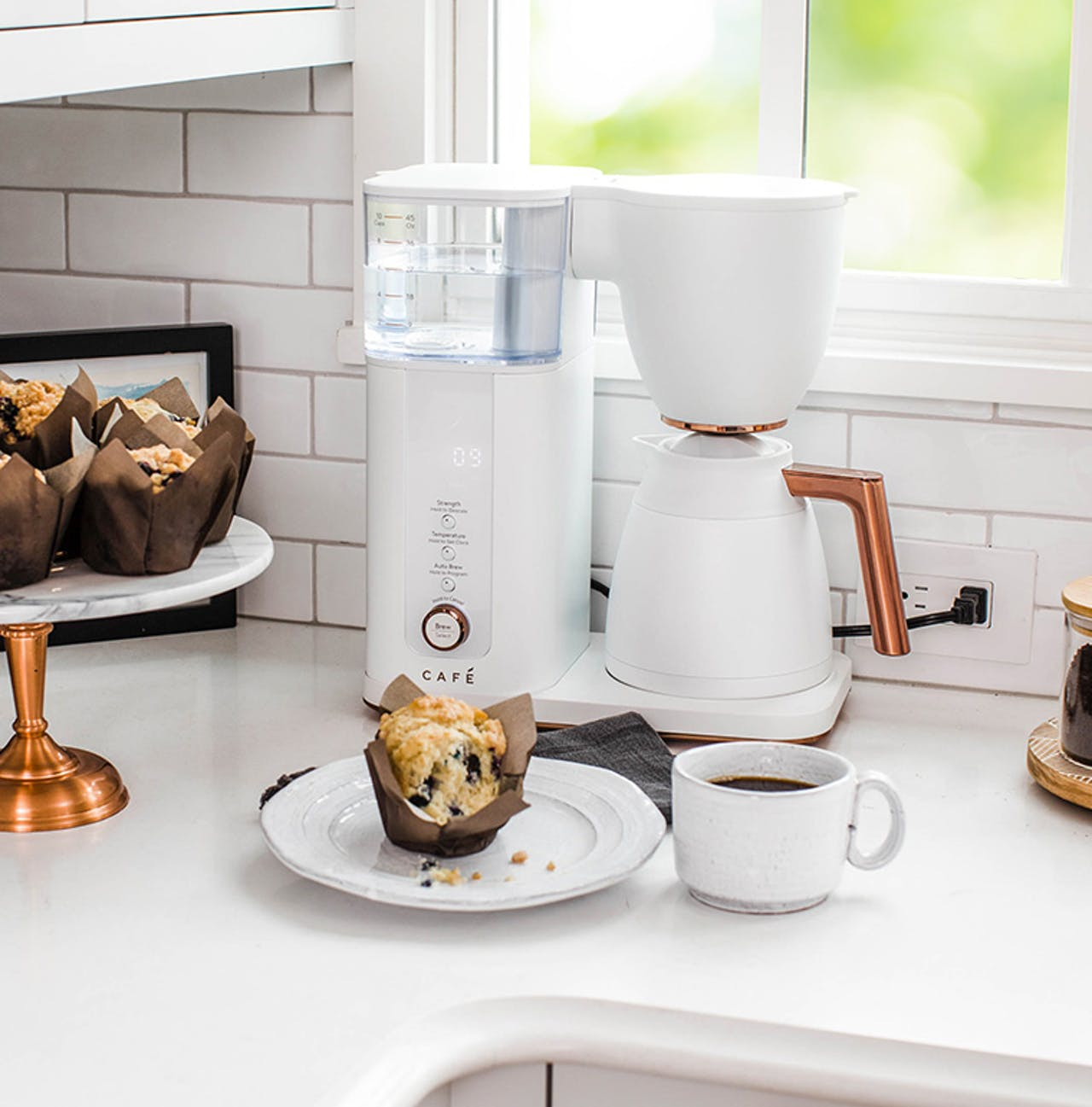 Cafe matte white coffee maker with muffin
