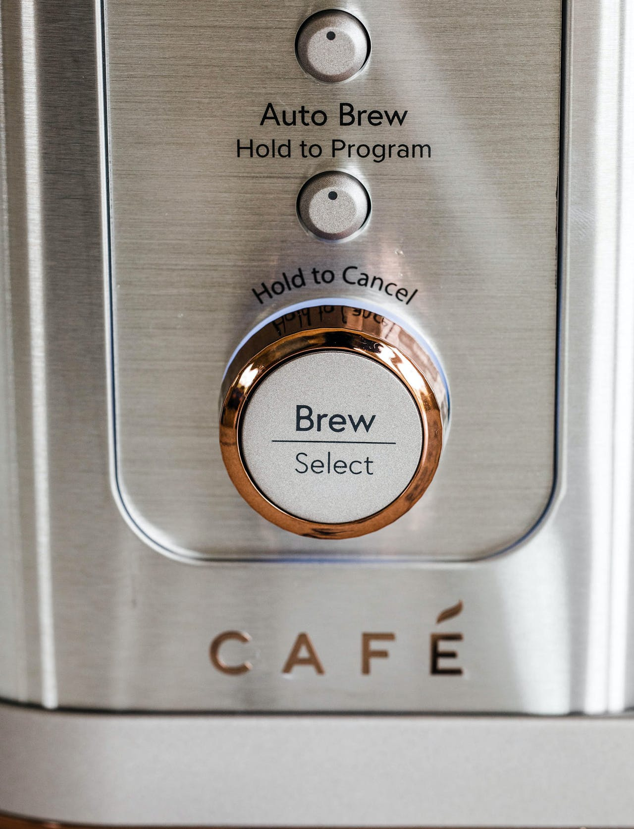 detail image of cafe coffee maker brew knob with copper accent
