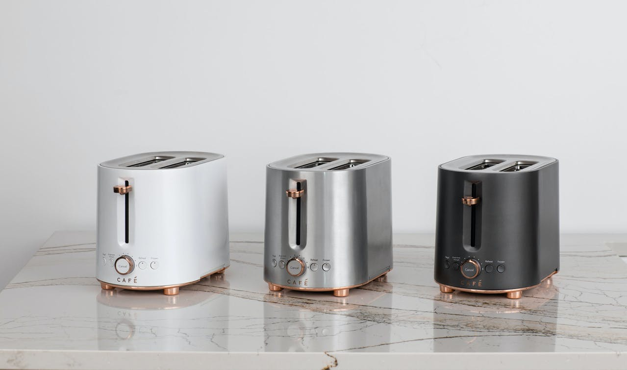 cafe toasters in matte white, stainless and matte black on countertop