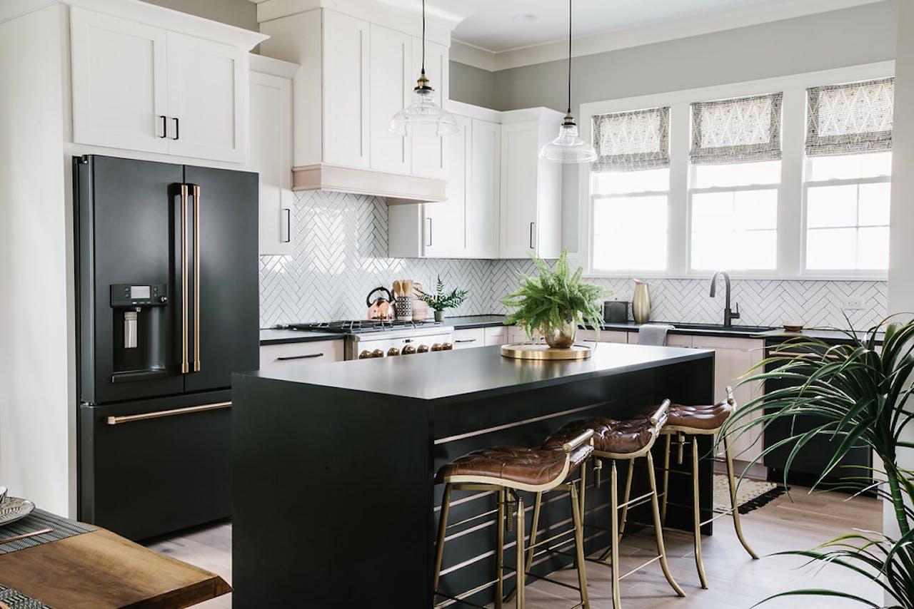Cambria countertops and matte black café appliances