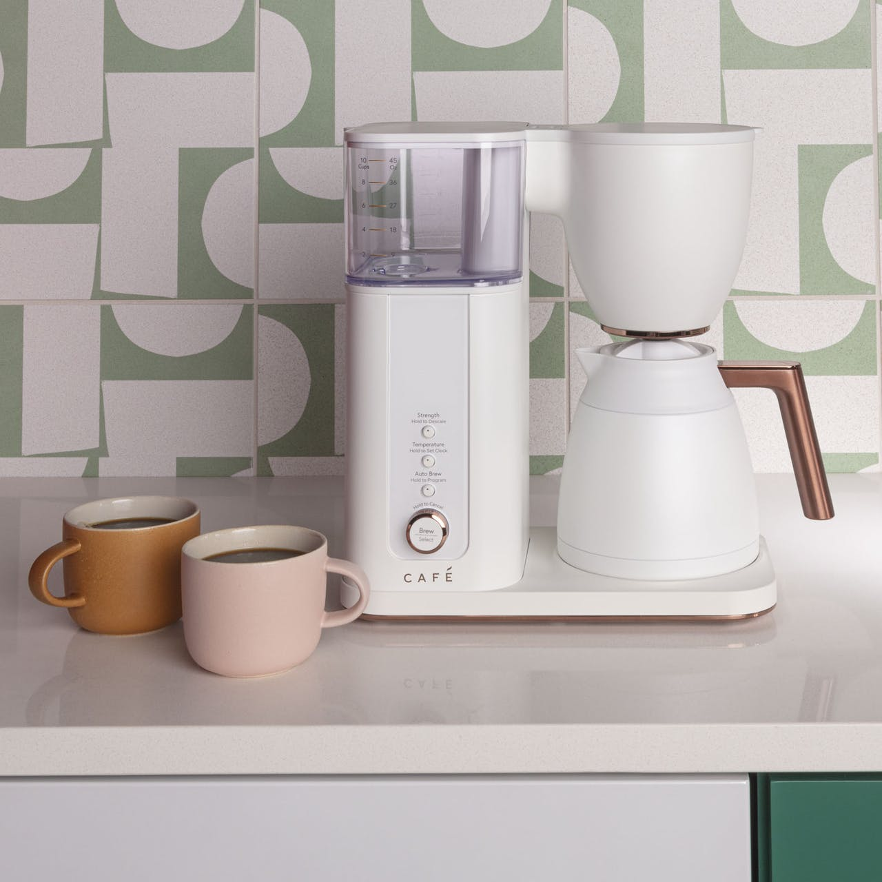 Café Specialty Drip Coffee Maker in matte white on counter with coffee cups