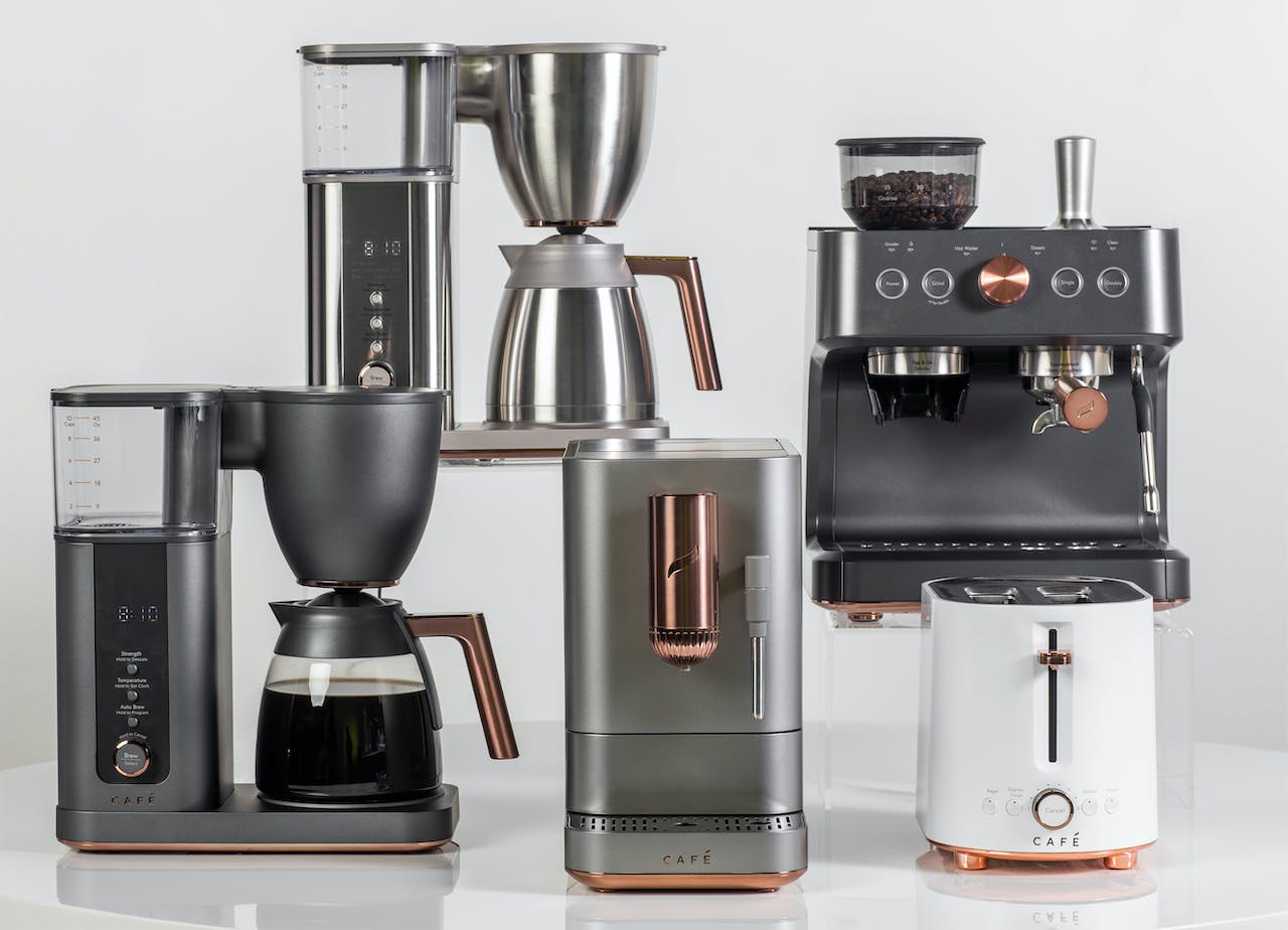 Grouping of Café Expressions Collection. Coffee Makers, Espresso Machines and toaster