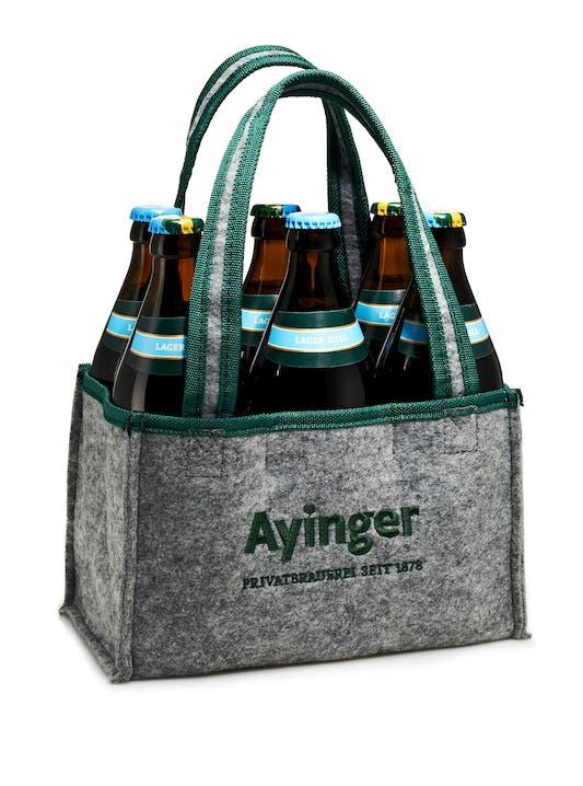 """Jetzt zum Newsletter """"Neues aus Aying"""" anmelden und als kleine Aufmerksamkeit einen Filz-Sixpack aus Aying bekommen."""