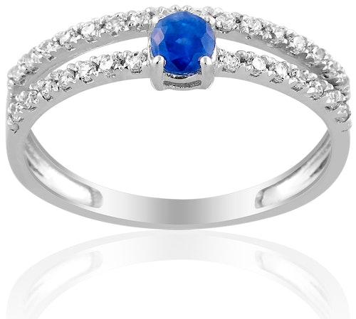Cette Bague CLEOR est en Or 375/1000 Blanc, Saphir Bleu et Oxyde