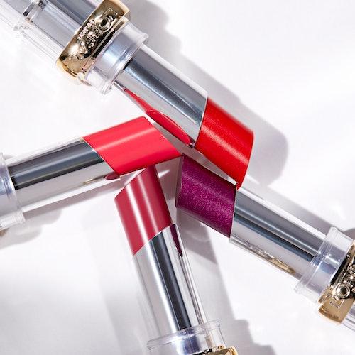 Flatlay image of 4 colourful L'Oreal lipsticks
