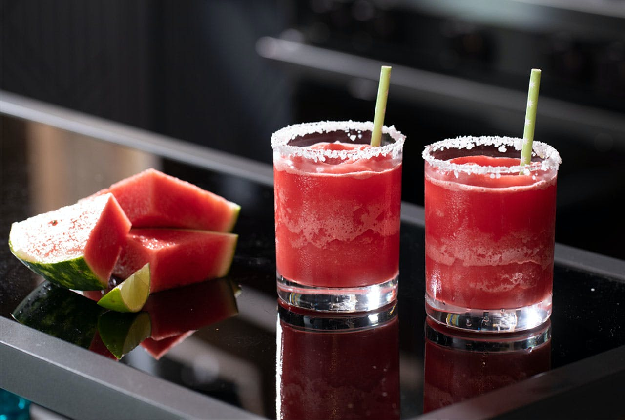 Two glasses of Frozen Watermelon Margaritas on Haier  kitchen counter