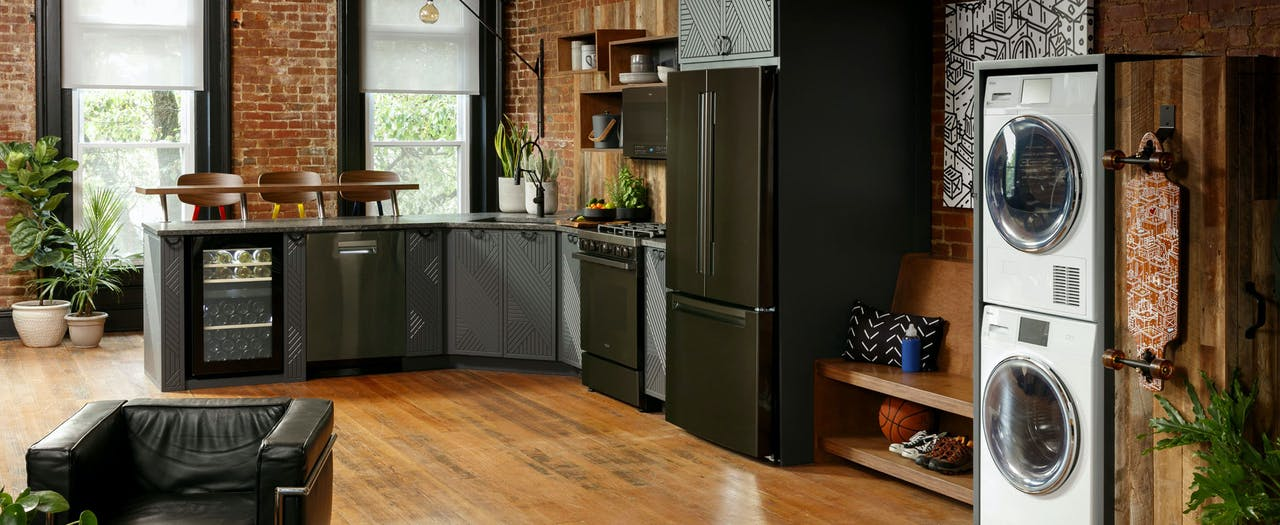 Beautiful Haier Kitchen featuring full-size appliances.