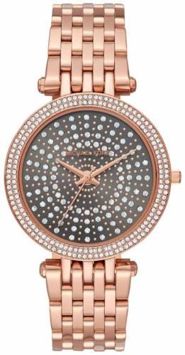 Cette montre MICHAEL KORS se compose d'un boîtier Rond de 47 mm et d'un bracelet en Acier Rose