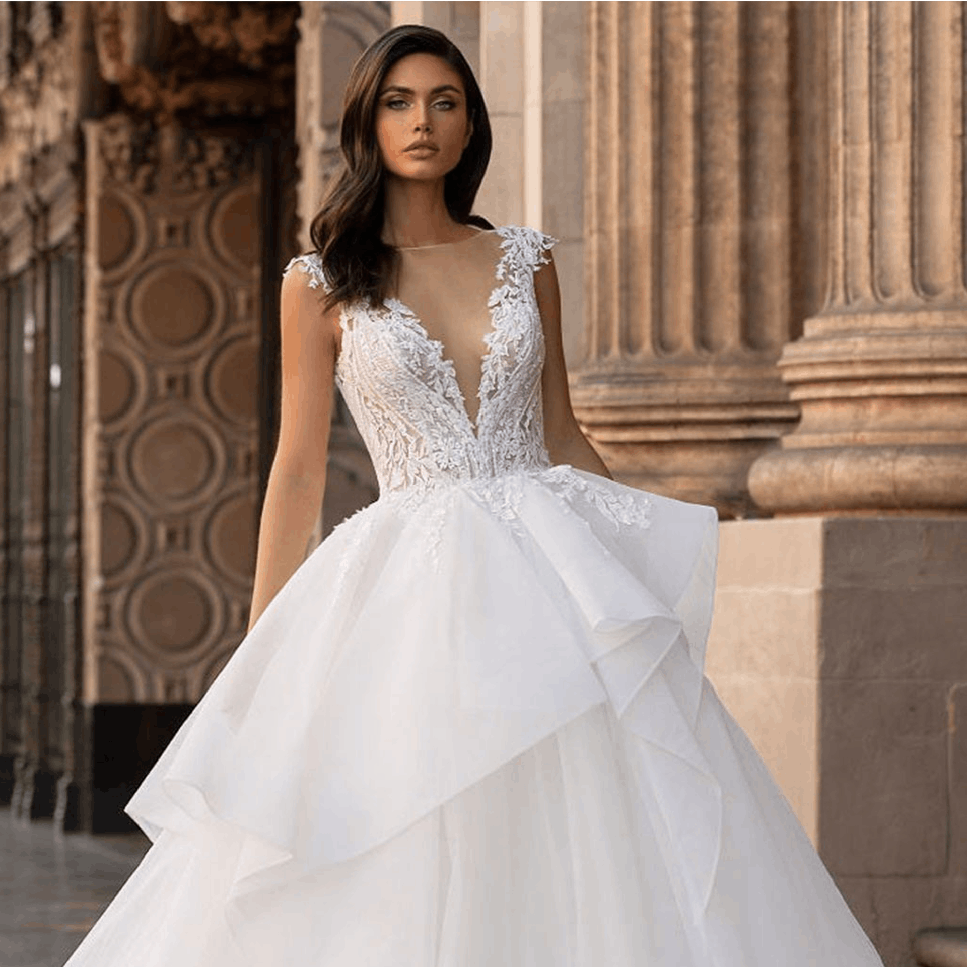 Woman in Pronovias Lace bodice and tulle skirt wedding dress